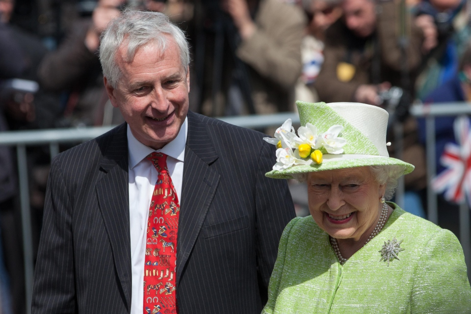 Hugo Vickers with Queen Elizabeth II,  from an event on April 21, 2016 in Windsor where she unveiled the Windsor Walkway – a four-mile self-guided walking trail created in honour of her Majesty being the longest reigning monarch. (Alamy)
