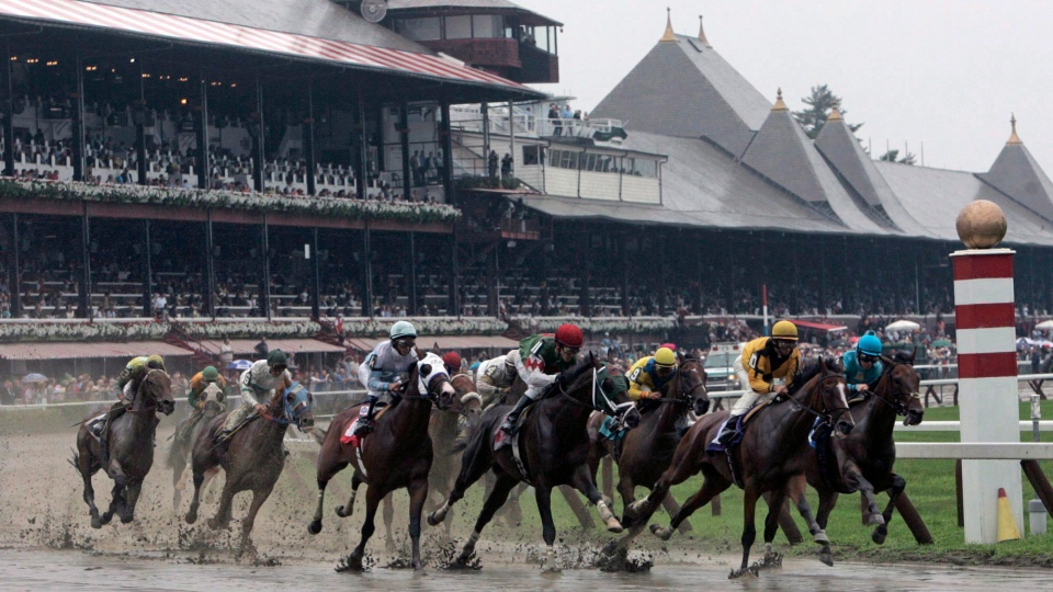 Horses race at Saratoga Race Course in Saratoga Springs, N.Y., Wednesday, July 23, 2008. (Mike Groll / The Associated Press)