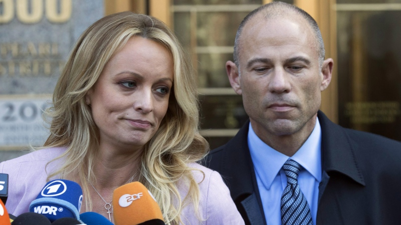 Stormy Daniels, left, stands with her lawyer Michael Avenatti outside federal court in New York, on April 16, 2018. (Mary Altaffer / AP)