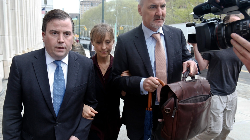 Actress Allison Mack, center, arrives with her legal team to Brooklyn Federal Court, Friday May 4, 2018, in New York. (AP Photo/Bebeto Matthews)