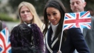 In this file photo, Markle arrives to take part in an event for young women as part of International Women's Day in Birmingham, central England Thursday, March 8, 2018. (Hannah McKay/Pool via AP)