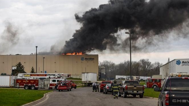 Firefighters wait for magnesium to burn off at Meridian Magnesium in Eaton Rapids, Michigan on May 2, 2018. (Photo courtesy of @mdslsj/Lansing State Journale via Twitter)