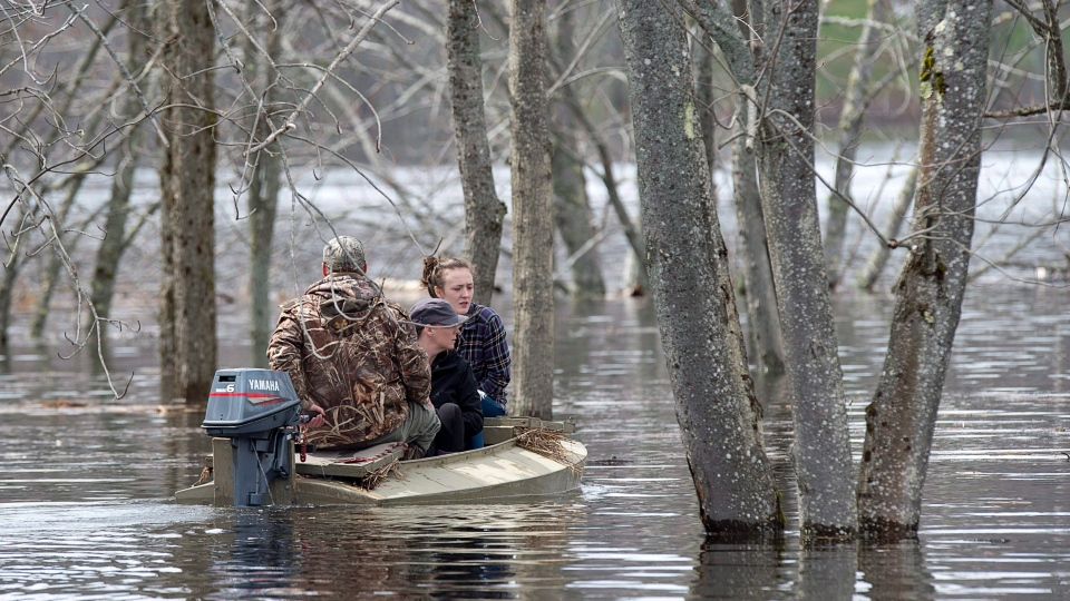 Residents are ferried at Darlings Island, N.B. as the Kennebecasis River flooded the only road into the community, on Friday, May 4, 2018. THE CANADIAN PRESS/Andrew Vaughan