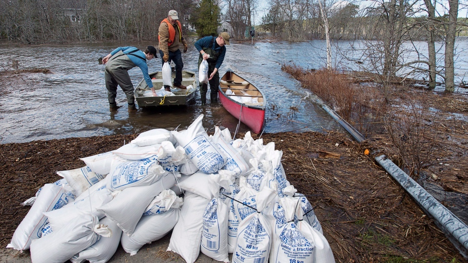 Residents transport sandbags to their homes cut off by flood waters in Rothesay, N.B. on Saturday, May 5, 2018. THE CANADIAN PRESS/Andrew Vaughan