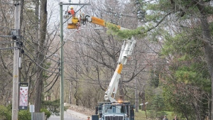 A Hydro Quebec crew works on restoring power in the town of Hudson, Que., west of Montreal, Saturday, May 5, 2018, following a storm in Quebec and parts of Ontario. THE CANADIAN PRESS/Graham Hughes