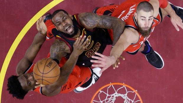 Cleveland Cavaliers  LeBron James. Cleveland Cavaliers  LeBron James (23) goes  up for a shot between Toronto ... db164eb93