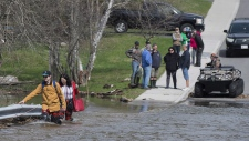 Crossing a flooded road in Saint John, N.B.
