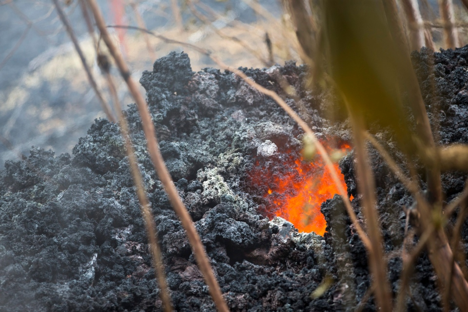 Lava glows from a vent on a lava bed at the Leilani Estates, Saturday, May 5, 2018, in Pahoa, Hawaii. (AP Photo/Marco Garcia)