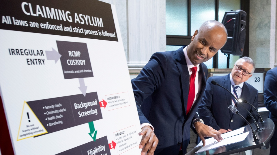Ahmed Hussen, Minister of Immigration, Refugees and Citizenship, discusses the situation of irregular migration as Ralph Goodale, Minister of Public Safety and Emergency Preparedness, looks on Monday, May 7, 2018 in Montreal. (Paul Chiasson / THE CANADIAN PRESS)