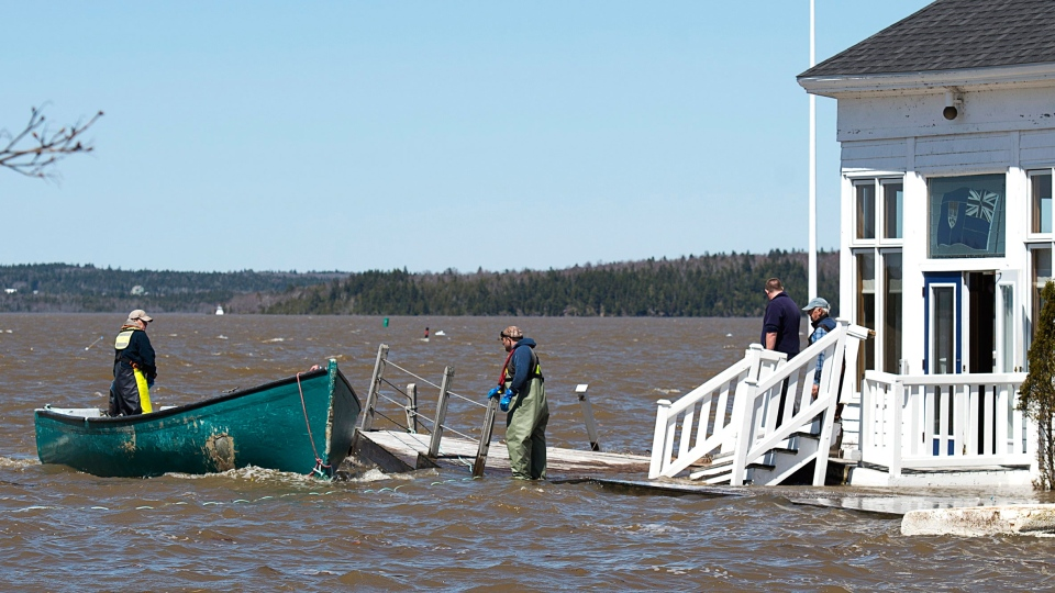 Sailors prepare to secure a work boat at the Royal Kennebecasis Yacht Club in Saint John, N.B. on Saturday, May 5, 2018. THE CANADIAN PRESS/Andrew Vaughan