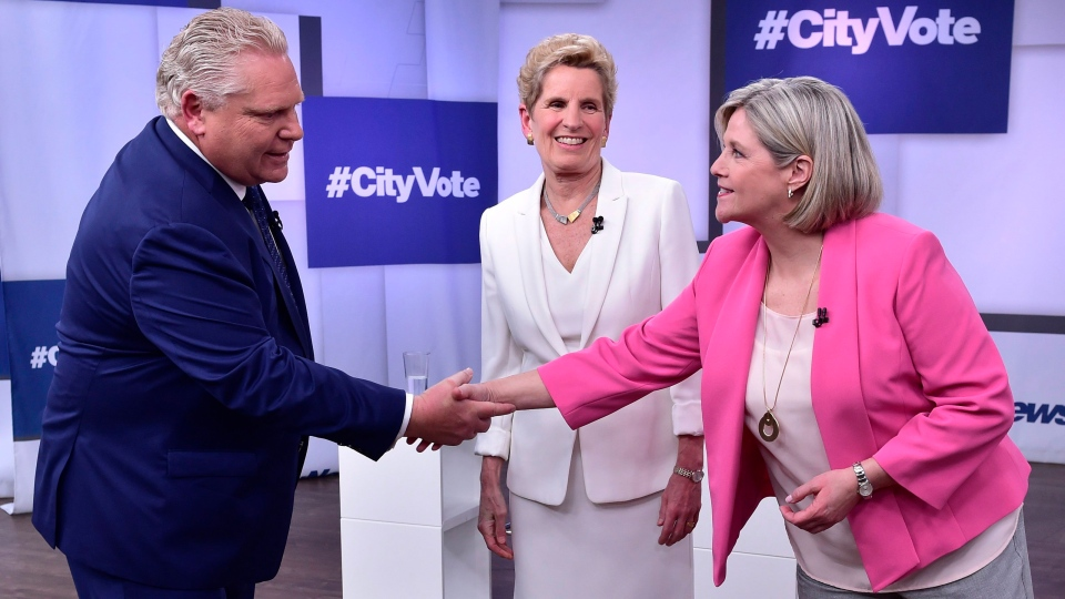 Liberal Premier Kathleen Wynne, centre, looks as Progressive Conservative Leader Doug Ford, left, and NDP Leader Andrea Horwath shake hands at the Ontario Leaders debate in Toronto on Monday, May 7, 2018. (THE CANADIAN PRESS/Frank Gunn)