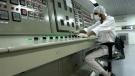 An Iranian technician works at the Uranium Conversion Facility just outside the city of Isfahan 410 kilometres south of the capital Tehran, Iran on Feb. 3, 2007. (AP Photo/Vahid Salemi)