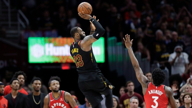 Cleveland Cavaliers  LeBron James (23) hits the game-winning shot as Toronto  Raptors  OG Anunoby (3) and CJ Miles (0) watch during the second half of  Game 3 ... 02f0041d4