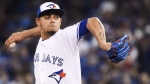 Toronto Blue Jays relief pitcher Roberto Osuna (54) pitches against the Milwaukee Brewers during ninth inning interleague baseball action in Toronto on Tuesday, April 11, 2017. THE CANADIAN PRESS/Nathan Denette