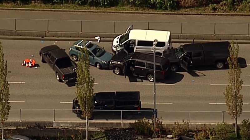 A number of vehicles remain stopped with their doors open following a shooting incident at the Departure Bay ferry terminal. May 8, 2018. (CTV Chopper 9)