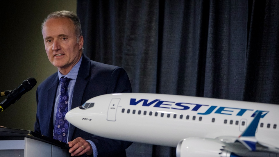 WestJet president and CEO Ed Sims addresses the airline's annual meeting in Calgary, Tuesday, May 8, 2018.THE CANADIAN PRESS/Jeff McIntosh