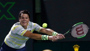 Milos Raonic, of Canada, reaches for a shot from Juan Martin del Potro, of Argentina, during the quarterfinals of the Miami Open tennis tournament Wednesday, March 28, 2018, in Key Biscayne, Fla. (THE CANADIAN PRESS/AP, Wilfredo Lee)