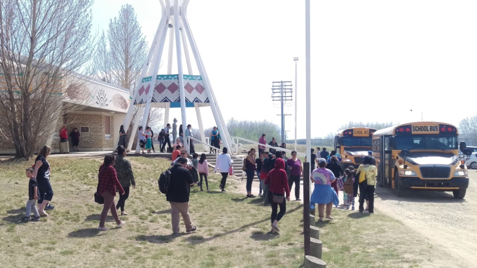 Students are seen leaving a school in Beardy's & Okemasis' Cree Nation after officials say a flaming rabbit sparked a wildfire nearby. (Source: Beardy's & Okemasis' Cree Nation)