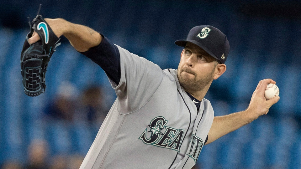 Seattle Mariners starting pitcher James Paxton throws against the Toronto Blue Jays in first inning American League MLB baseball action in Toronto on Tuesday May 8, 2018. THE CANADIAN PRESS/Fred Thornhill