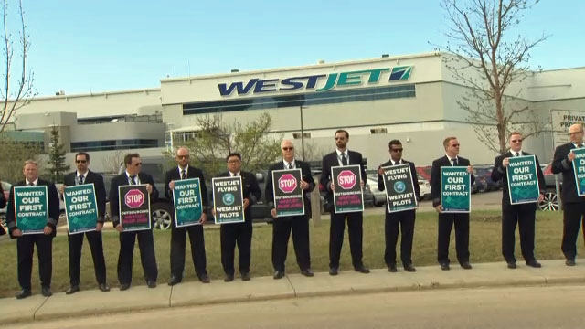 Pilots picket outside the WestJet building in Calgary on Tuesday, May 8, 2018 during the airline's annual general meeting