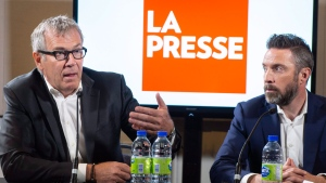 La Presse publisher Guy Crevier, left, responds to a question as president Pierre-Elliott Levasseur looks on during a news conference Tuesday, May 8, 2018 in Montreal. Montreal-based La Pressenews group says it plans to adopt a not-for-profit structure if Quebec repeals a provision allowing it to do so. THE CANADIAN PRESS/Paul Chiasson