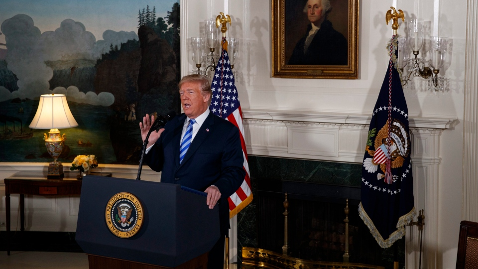 U.S. President Donald Trump delivers a statement on the Iran nuclear deal from the Diplomatic Reception Room of the White House, Tuesday, May 8, 2018, in Washington. (AP Photo/Evan Vucci)
