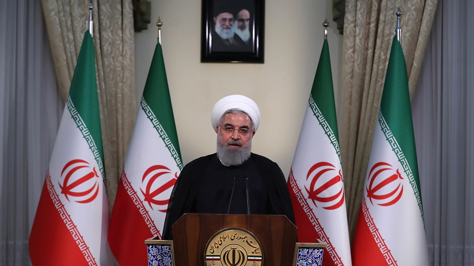 In this photo released by official website of the office of the Iranian Presidency, President Hassan Rouhani addresses the nation in a televised speech in Tehran, Iran, Tuesday, May 8, 2018. (Iranian Presidency Office via AP)