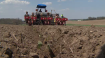 A transplanter being used to put strawberries in the ground at Herrle's Country Farm Market.