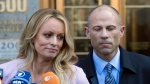 In this April 16, 2018, file photo, adult film actress Stormy Daniels, left, stands with her lawyer Michael Avenatti as she speaks outside federal court in New York. (AP Photo/Mary Altaffer, File)