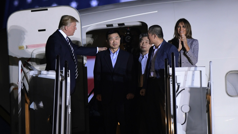 U.S. President Donald Trump, from left, greets Tony Kim, Kim Hak Song and Kim Dong Chul, three Americans detained in North Korea for more than a year, as they arrive at Andrews Air Force Base in Md. on Thursday, May 10, 2018. (AP Photo/Susan Walsh)