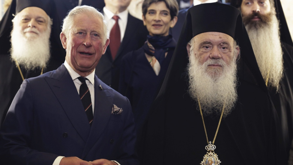 Prince Charles, left, poses for a group photo next to the head of Greece's Orthodox Church Archbishop Ieronymos, after their meeting in Athens, on May 10, 2018. (Petros Giannakouris / AP)