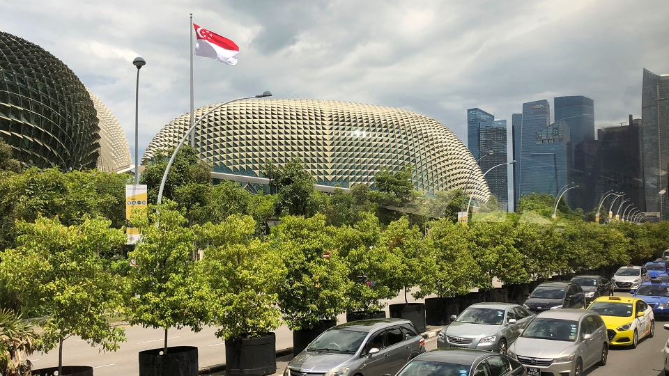 The national flag of Singapore flies against the financial skyline lining the edge of the Singapore River on Thursday, May 10, 2018, in Singapore. (AP / Wong Maye-E)