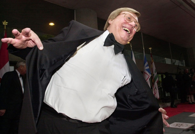 Walter Ostanek jokes with reporters about buying a new tuxedo after unveiling his star at his induction into the Walk of Fame along King Street, Friday, June 1, 2001 in Toronto. (J.P.Moczulski / THE CANADIAN PRESS)