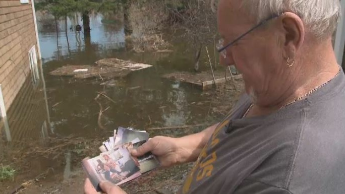 Tim Humphrey has been reunited with some precious family photos after they were swept away by floodwaters in Grand Bay-Westfield, N.B.