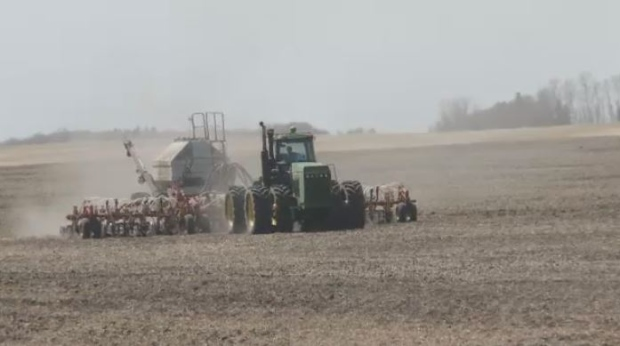 Farmers work on a field near Yorkton on May 10, 2018