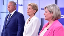 Liberal Premier Kathleen Wynne, centre, Progressive Conservative Leader Doug Ford, left, and NDP Leader Andrea Horwath stand together before the start of their debate in Toronto on Monday, May 7, 2018. THE CANADIAN PRESS/Frank Gunn
