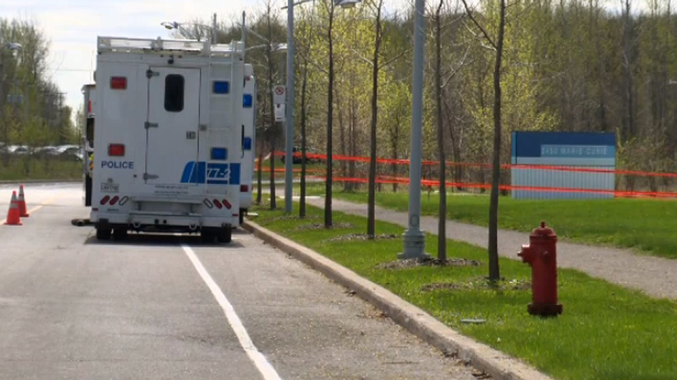 A Montreal police mobile command centre was brought to the Technopark where a body was discovered on Friday May 11, 2018.