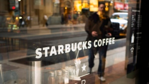The front window of a downtown Starbucks Coffee store is shown in Toronto, May 10, 2018. THE CANADIAN PRESS/Graeme Roy