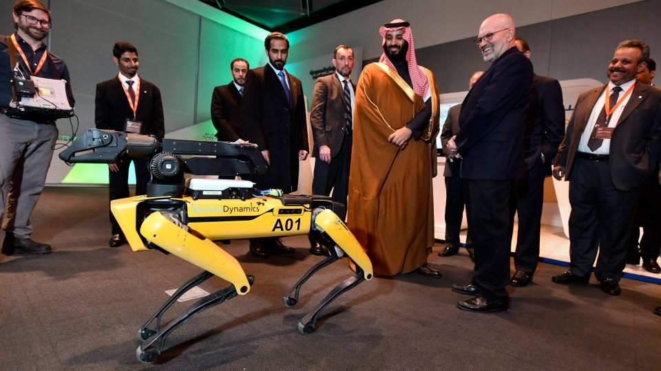 HRH Crown Prince Mohammed bin Salman tours an innovation gallery of Saudi Arabian technology, including a robotic 'SpotMini' dog presented by Boston Dynamics CEO Marc Raibert, during a visit to Massachusetts Institute of Technology on Saturday, March 24, 2018 in Cambridge, Mass. (Josh Reynolds/AP Images for KAUST)