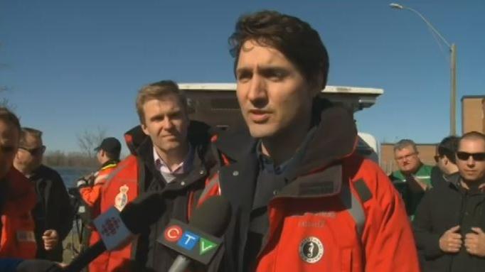 Prime Minister Justin Trudeau surveys flood damage in Oromocto, N.B. on May 11, 2018.
