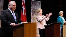 Ontario Progressive Conservative Leader Doug Ford, left to right, Ontario Liberal Leader Kathleen Wynne and Ontario NDP Leader Andrea Horwath applaud as they finish taking part in the second of three leaders' debate in Parry Sound, Ont., on Friday, May 11, 2018. THE CANADIAN PRESS/Nathan Denette