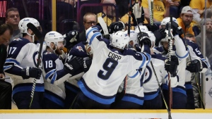 Winnipeg Jets players celebrate after a goal against the Nashville Predators late in the third period in Game 7 of an NHL hockey second-round playoff series Thursday, May 10, 2018, in Nashville, Tenn. The Jets won 5-1. (AP Photo/Mark Humphrey)