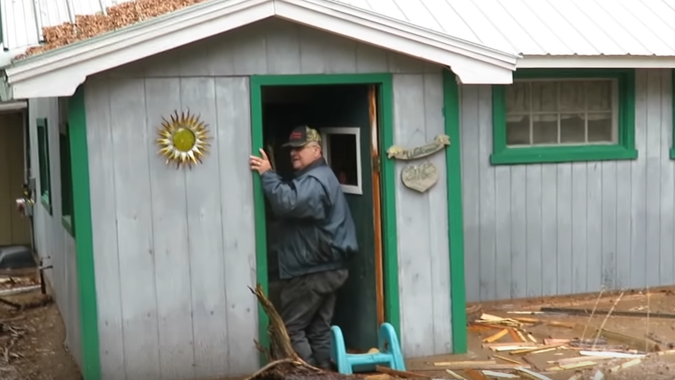 Darlene McNee films her husband Robert as he attempts to survey damage at their cottage in Chipman, N.B., in this recent handout photo taken from video. )THE CANADIAN PRESS/HO - Darlene McNee)
