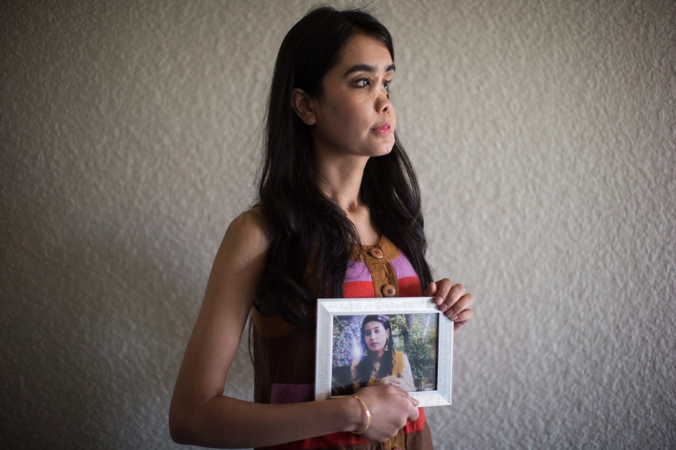Shakila Zareen holds a photograph of herself as a teenager. (THE CANADIAN PRESS/Darryl Dyck)