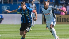 Montreal Impact's Ignacio Piatti, left, chases Philadelphia Union's Mark McKenzie during first half MLS action in Montreal on Saturday, May 12, 2018. THE CANADIAN PRESS/Peter McCabe