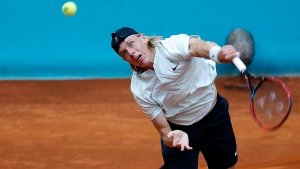 FILE -- Denis Shapovalov, of Canada, returns the ball to Kyle Edmund, of Britain, during the Madrid Open tennis tournament in Madrid, Spain, Friday, May 11, 2018. (AP Photo/Paul White)