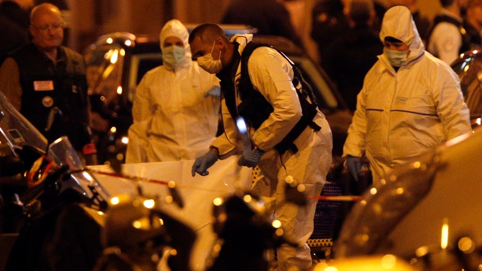 Scientific police officers investigate after a knife attack in central Paris, Saturday May 12, 2018.(AP Photo/Thibault Camus)