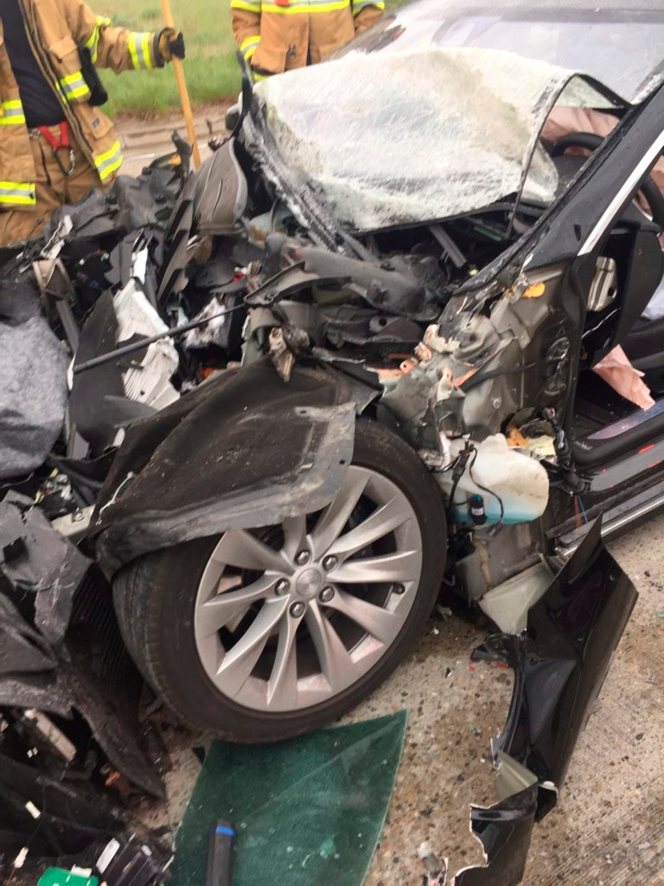 In this Friday, May 11, 2018, photo released by the South Jordan Police Department shows a traffic collision involving a Tesla Model S sedan with a Fire Department mechanic truck stopped at a red light in Utah. Witnesses indicated the Tesla Model S did not brake prior to impact. (South Jordan Police Department via AP)