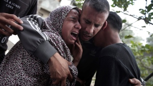 Relatives of 40 year-old Palestinian Jaber Abu Mustafa react at the family house during his funeral in town of Khan Younis, southern Gaza Strip, Saturday, May 12, 2018. (AP Photo/Khalil Hamra)