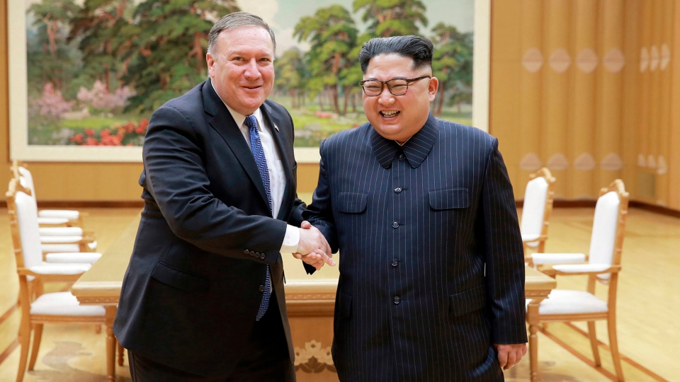 U.S. Secretary of State Mike Pompeo, left, shakes hands with North Korean leader Kim Jong Un during a meeting at Workers' Party of Korea headquarters in Pyongyang, North Korea on Wednesday, May 9, 2018. (Korean Central News Agency/Korea News Service)
